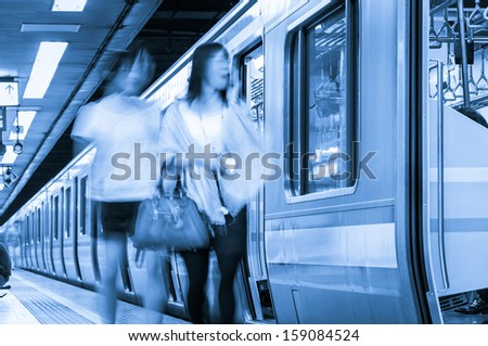 Commuters move in a blur along the Tokyo Metro.