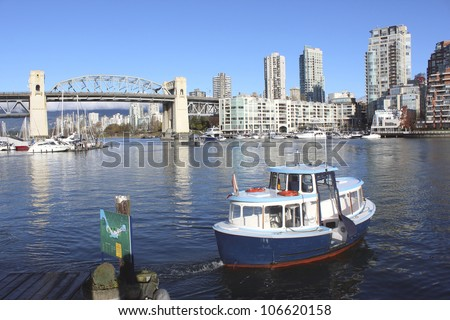 Commuting along Vancouver's False Creek on the British Columbia West Coast/Ferry Commute/Transportation along Vancouver's False Creek on the BC west coast - stock photo