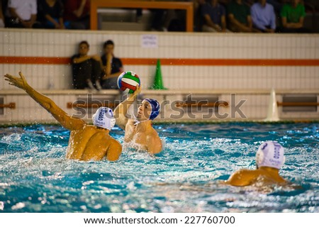COMO,  OCTOBER 18:  A. Razzi ( 11 dark cap  Bpm Sport Management) in  Como Nuoto - BPM Sport Management  ( Italian Premier League)  on October 18, 2014 , Como ( Italy).