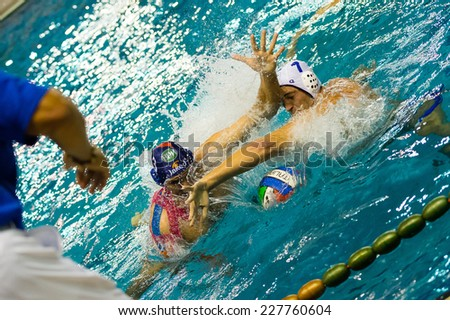 COMO,  OCTOBER 18:   L. Binchi (Bpm Sport Management, 3, dark cap) in  Como Nuoto - BPM Sport Management  ( Italian Premier League)  on October 18, 2014 , Como ( Italy). - stock photo