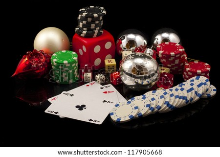 comoposicion Christmas with poker chips, cards and dice, isolated on black
