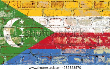 Comoros flag painted on old brick wall texture background - stock photo