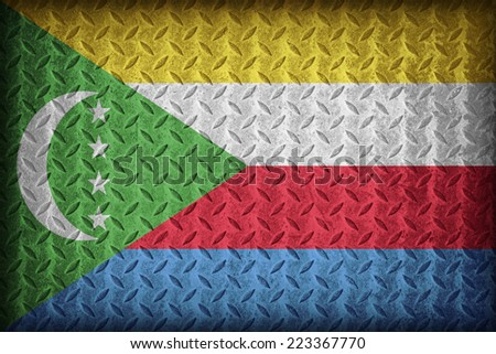 Comoros flag pattern on the diamond metal plate texture ,vintage style - stock photo