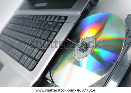 Compact disc close up on laptop computer (shallow DOF)