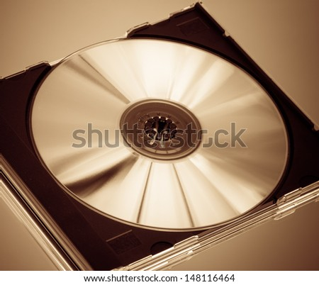 Compact disc in case, sepia toned - stock photo