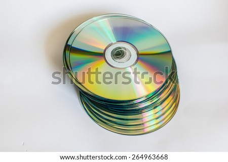 compact discs and digital versatile disc on a white background - stock photo