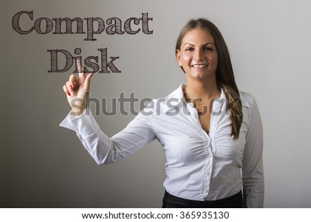 Compact Disk - Beautiful girl touching text on transparent surface - horizontal image - stock photo