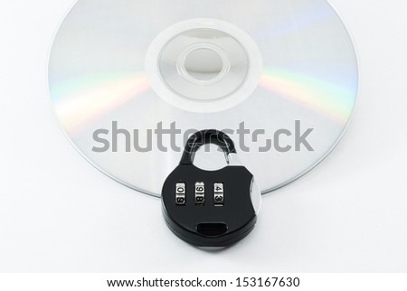compact disk with a security lock on it conceptual isolated image - stock photo