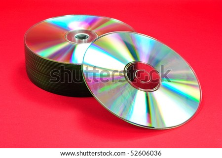 Compact Disks on Red Background