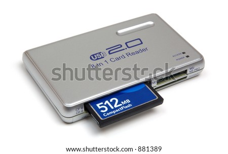 Compact flash card reader with 512MB card, isolated on white background