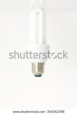 compact fluorescent lamps on white background - stock photo