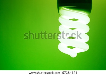 Compact fluorescent light bulb. - stock photo