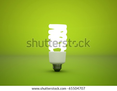 Compact fluorescent light bulb green background - stock photo