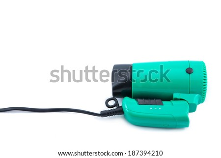 Compact green hair dryer on a white background