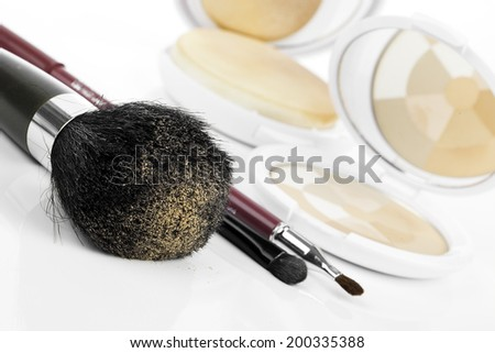 compact powder and black brush isolated - stock photo