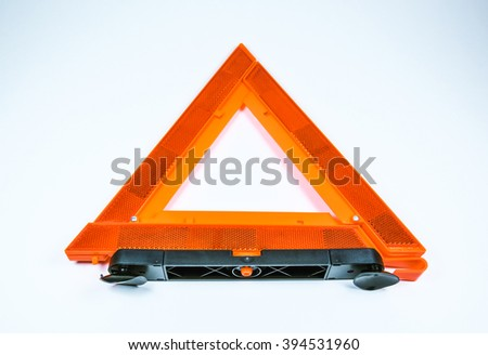 compact triangle warning signal on white background.