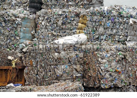 Compacted recyclable plastic and paper waste at a recycling plant. - stock photo