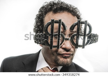 company businessman with funny face and glasses-shaped silver dollar - stock photo