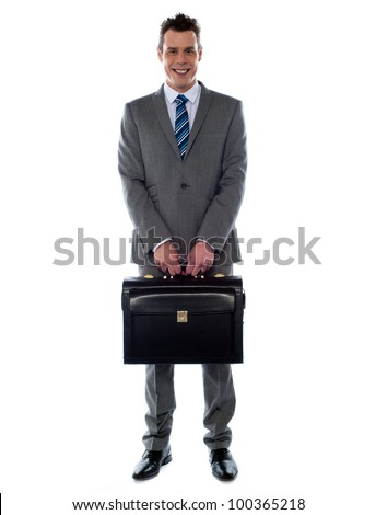 Company CEO holding his handbag in front of camera - stock photo