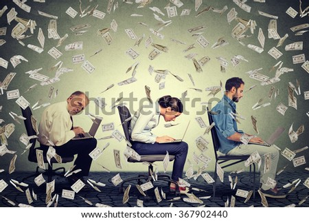 Company employees men young woman sitting on chair working on laptops making money under dollar banknotes rain. Successful internet business concept  - stock photo