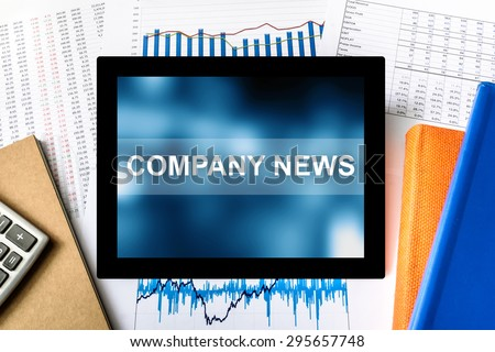 company news word on tablet with financial graph background - stock photo