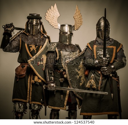 Company of medieval knights in armour - stock photo