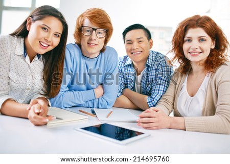 Company of smart and happy groupmates in casual clothes - stock photo