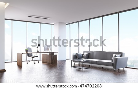 Company's head office with gray sofa, coffee table, computer desk and panoramic windows. 3d rendering