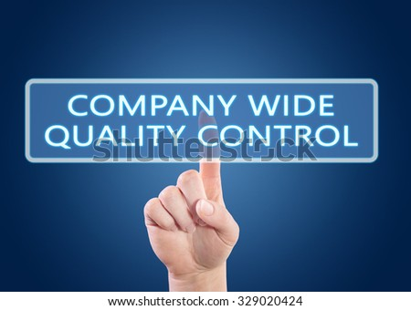 Company Wide Quality Control - hand pressing button on interface with blue background. - stock photo