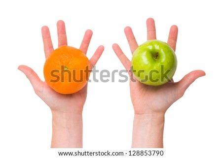 Compare apples with oranges (conceptual) - stock photo