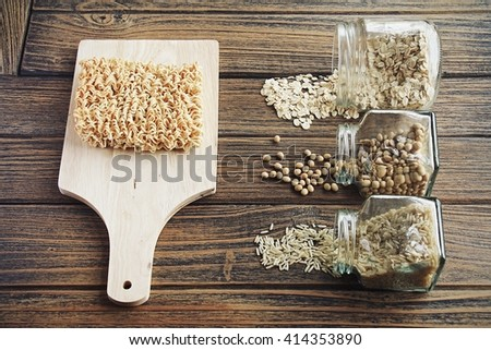 Comparison between instant noodle and others good dried food, Unhealthy and healthy ingredients. Dried whole grain food (Rice, Soybean, Rolled oat,) (Color Process) - stock photo