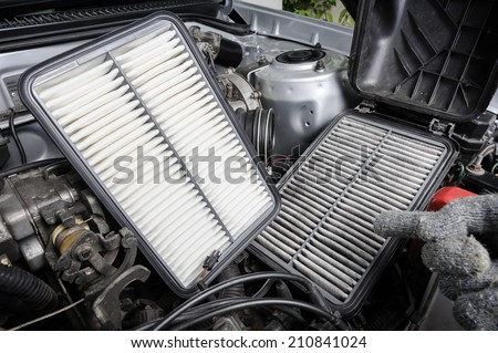 comparison between new and used air filter for car, automotive spare part  - stock photo