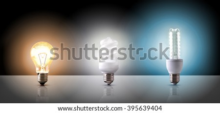 Comparison between various types of light bulb on black background. Horizontal composition. Front view - stock photo