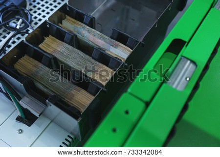 compartment for cash in an ATM, banknotes prepared for issuance to customers. modern technologies in the banking sector.