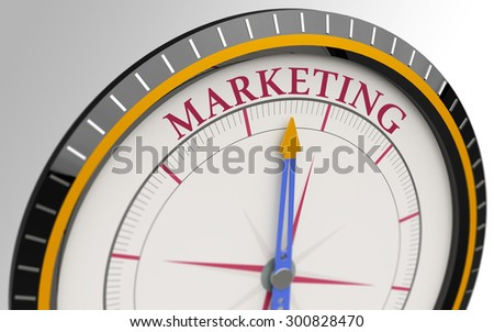 Compass and an arrow pointing to the word marketing - stock photo