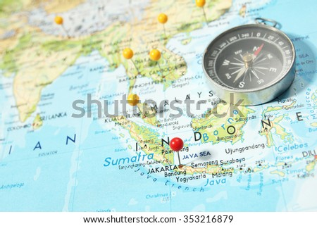 Compass pins on map focus on stock photo royalty free 353216879 compass and pins on map with focus on jakarta capital indonesia freerunsca Gallery