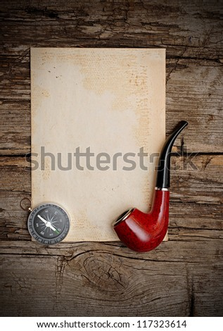 Compass and pipe on the old paper background - stock photo