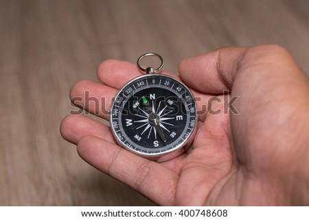 Compass and point to North on hand. - stock photo