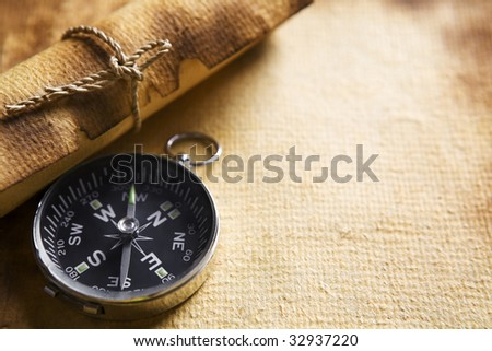 Compass and scroll on old paper