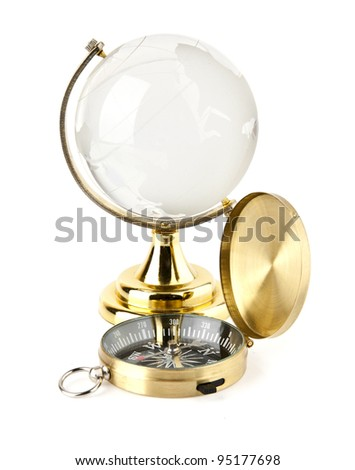 compass and the globe on a white background - stock photo
