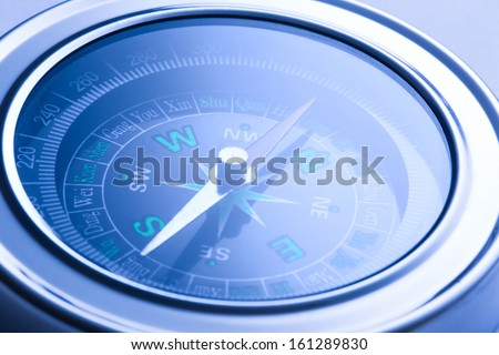 Compass closeup in blue toning - stock photo