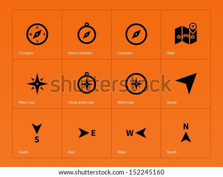 Compass icons on orange background. See also vector version. - stock photo