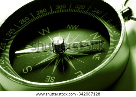 Compass in green toning color in closeup - stock photo