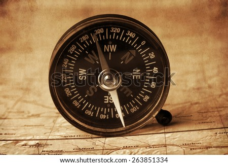 compass in the open map atlas,vintage texture - stock photo