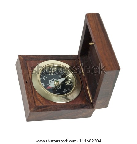 Compass in wooden box used for navigational purposes - path included