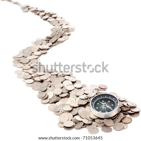 Compass is at the beginning of the road from coins - stock photo