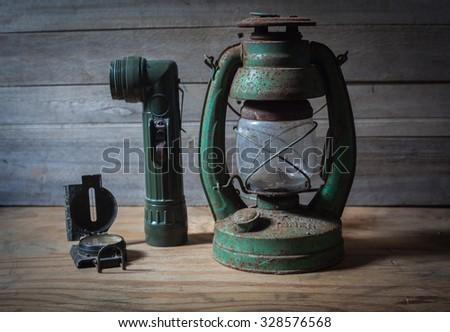 Compass lantern knife hiking equipment. - stock photo