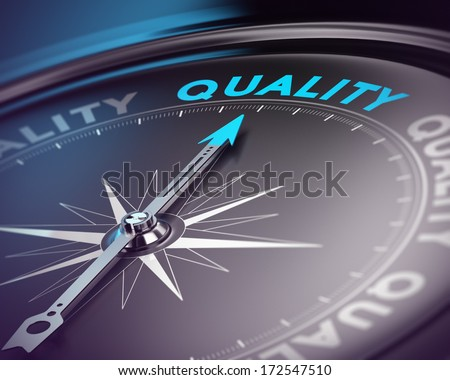 Compass needle pointing the blue text. Blue and black tones with blur effect and focus on the main word. Concept for quality assurance management. - stock photo