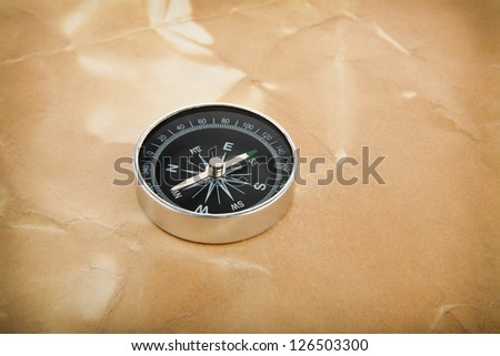 compass on a background an old paper - stock photo