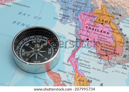 Compass on a map pointing at Thailand and planning a travel destination - stock photo